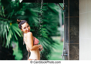 Shower On Beach. Beautiful Fit Woman Taking Shower At...