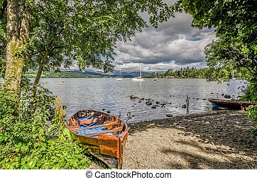 Boats on shore of Lake Windermere - Dilapidated rowing boat...