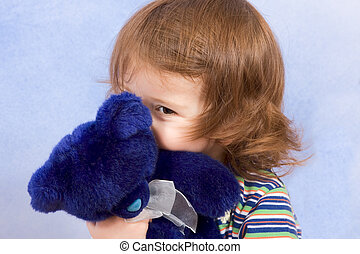 peek-a-boo - child peeking from blue teddy bear - peekaboo -...
