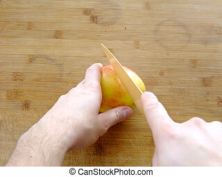 Cutting an Apple - Man is cutting an Apple with a Kitchen...
