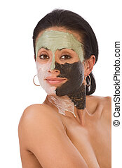 skincare - color facial mask on ethnic woman - Hand of...