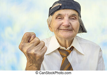 Elderly woman showing fig sign.