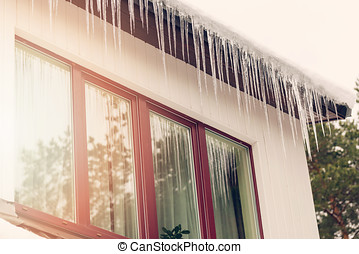 heat loss - icicles hanging on house roof