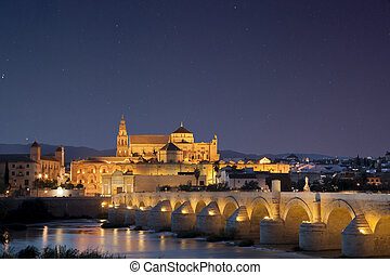 Bridge and Mosque of Cordoba under starry sky - Roman bridge...