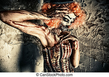 creature disgusting - Bloody scary clown. Halloween. Horror.