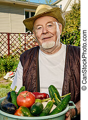 good harvest - Smiling senior man with his harvest in the...