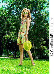 sunny lightness - Beautiful romantic girl walking in the...