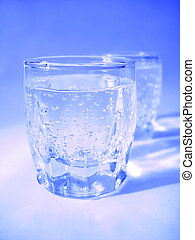 Glass with water in blue color
