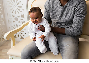 African American dad with his mixed race baby son