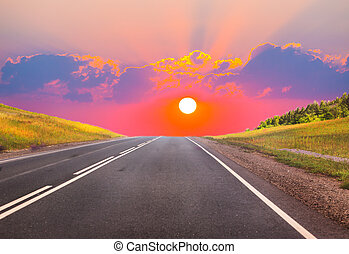 sunset over the country highway