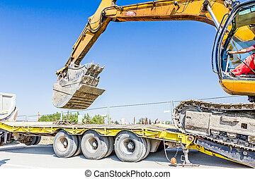 Loading excavator on semi trailer - Heavy excavator it...