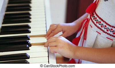 Playing piano child