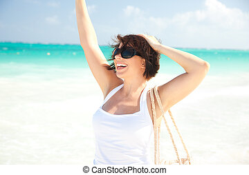 happy woman at the beach - picture of happy woman at the...