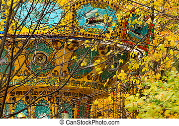 A colorful carousel in amusement park.