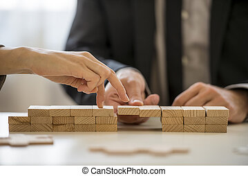 Business teamwork and cooperation concept - male hand...