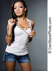 Sexy fashionable mulatto woman in a t-shirt