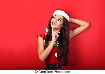 Happy smiling relaxing woman in santa claus christmas...