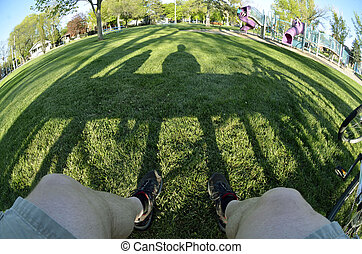 Person sitting on park bench fisheye - Person sitting on...