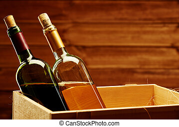 Bottle of red and white wine in wooden box.