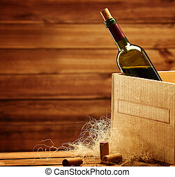 Bottle of wine in box in wooden interior.