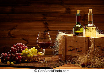 Bottles of red and white wine on a wooden interior.