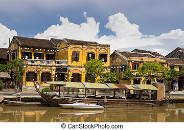 Hoi An - Wooden boats on the Thu Bon River in Hoi An Ancient...