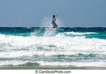 kite surfer - unrecognized kite surfer in the waves