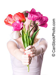 Young woman stretching flowers. Isolated on white.