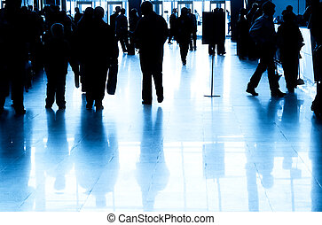 Business people silhouette in modern interior. Blue tint.