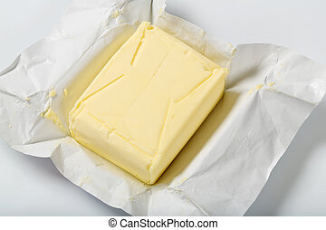 block of fresh butter on a wrapper