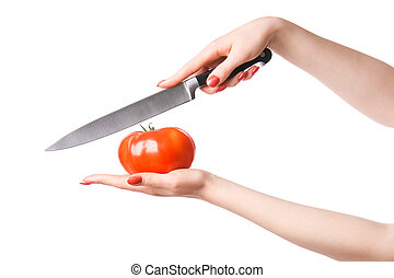Woman hands with knife cuting tomato