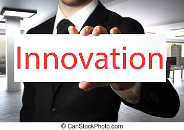 businessman holding sign innovation - businessman in office...