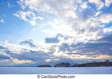 winter landscape with lake, forest and sky