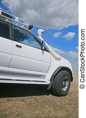 modern SUV in the summer - white modern SUV in the summer on...
