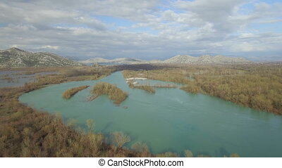 Aerial view of Moraca river which flows into beauty big...