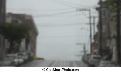 cab on San Francisco hill - a cab crosses a hilltop...