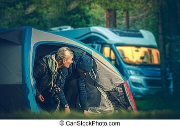 Couples Tent Camping. Men and Woman in Their 30s Camping in...