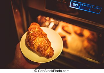 Baking Tasteful Croissants. Fresh Croissant Breakfast.