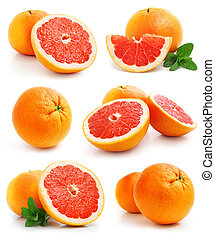 set of grapefruit fruits with cut and green leaves isolated...