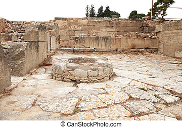 Ancient water well in Faistos - Ancient courtyard with...