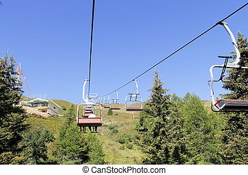 chairlift on the mountains of the Alps in northern Italy