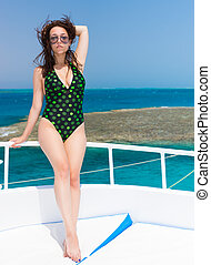 Very attractive woman standing on the yacht at a sunny...