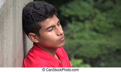 Teen Hispanic Boy Contemplative Silent And Alone