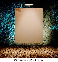Blank white poster in dark concrete room.