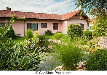 Family house with garden - Family house with pond in garden...