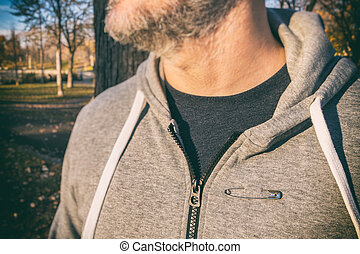 Man wearing a safety pin as a symbol of solidarity