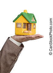 small model house on a male hand