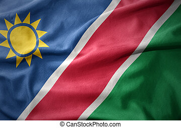waving colorful flag of namibia. - waving colorful national...