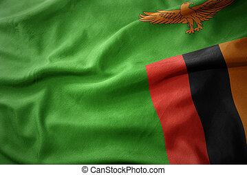 waving colorful flag of zambia. - waving colorful national...
