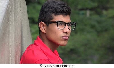 Serious Teen Hispanic Male Wearing Glasses